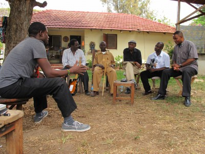 Benson Rukantabula, THP co-founder, interviews the musicians at Makutano House, Oyster Bay, Dar es Salaam